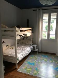 Un ou plusieurs lits superposés dans un hébergement de l'établissement Belle maison familliale