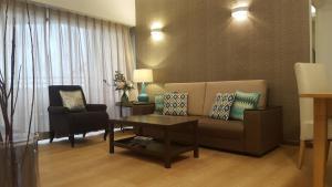 Ruang duduk di Batu Ferringhi Seaview Apartment