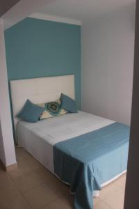 A bed or beds in a room at Apartamento Mar