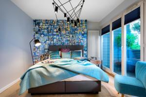 A bed or beds in a room at Privilege Suites