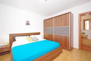 Postel nebo postele na pokoji v ubytování Apartments Imgrund