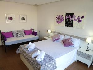 A bed or beds in a room at Gran Bulevar