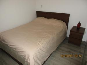 A bed or beds in a room at Luxury Furnished Corporate Suite in Downtown Toronto