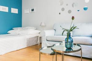 Ein Bett oder Betten in einem Zimmer der Unterkunft Apartament Rozbrat