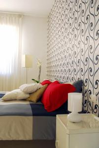 A bed or beds in a room at Meta Italy da Fabrizio