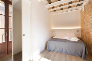 Letto o letti in una camera di Decô Apartments Barcelona-Born Apt.
