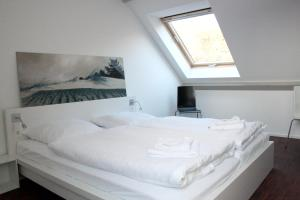 เตียงในห้องที่ Haus Düne31