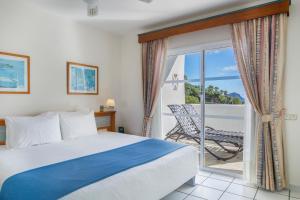 Un ou plusieurs lits dans un hébergement de l'établissement Santa Barbara Golf and Ocean Club By Diamond Resorts