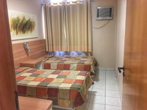 A bed or beds in a room at RQ Turismo - Res. Thermas Paradise