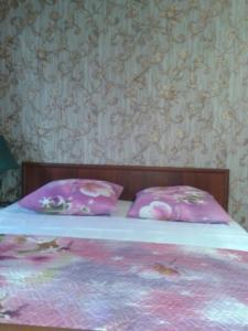 Кровать или кровати в номере Апартаменты на Водопьянова 1