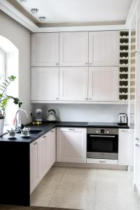 A kitchen or kitchenette at Old City by MKPL Apartments
