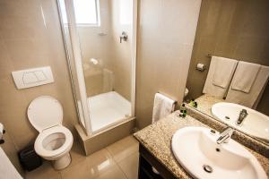 A bathroom at Coastlands Durban Self Catering Holiday Apartments