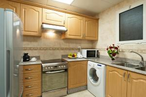 A kitchen or kitchenette at Saray Musheireb Hotel and Suites