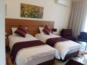 A bed or beds in a room at Sea Valley
