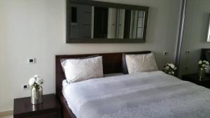 מיטה או מיטות בחדר ב-סוויטות לה פלמורה