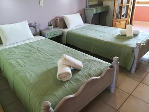 A bed or beds in a room at Olga's Garden Apartments