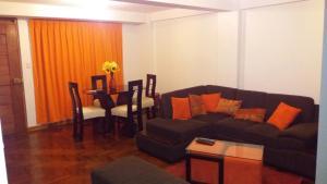 Zona de estar de Tikas House Apartment