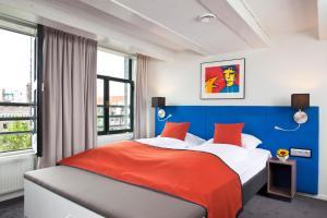 Vuode tai vuoteita majoituspaikassa Hapimag Resort Amsterdam