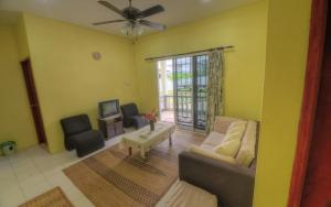 A seating area at Budget Umi Homestay Kuching