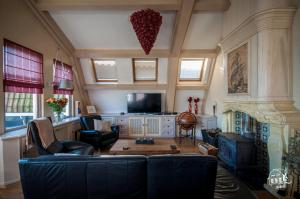 Zona de estar de Zaanhof –Luxurious Amsterdam Zaanse Schans Loft Apartment