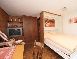 Ein Bett oder Betten in einem Zimmer der Unterkunft Studio Saclentse