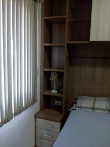 A bed or beds in a room at Ajuricaba Suites 6