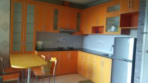 A kitchen or kitchenette at Adaru Apartment at MOI Kelapa Gading