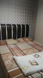 A bed or beds in a room at Adaru Apartment at MOI Kelapa Gading