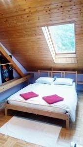 Postel nebo postele na pokoji v ubytování Apartman pod Svatou Horou
