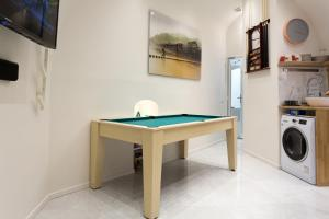 A pool table at Louvre Luxury Apartment & SPA
