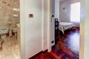 A bunk bed or bunk beds in a room at San Giovanni Comfort Apartment