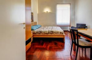 A bed or beds in a room at San Giovanni Comfort Apartment