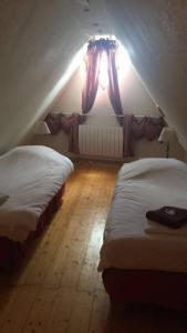 Un ou plusieurs lits dans un hébergement de l'établissement Gîte Maison des Vignerons