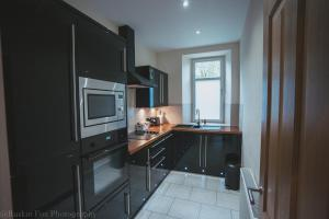 A kitchen or kitchenette at Apartment B
