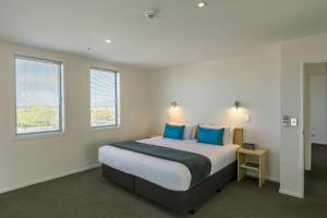 A bed or beds in a room at Quest Christchurch Serviced Apartments