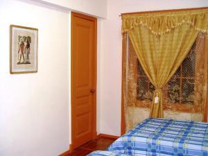 Cama o camas de una habitación en Opera Santiago