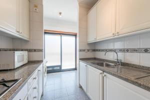 A kitchen or kitchenette at TPC Tullins Palmeira