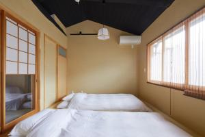 A bed or beds in a room at Nakano-an