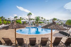 The swimming pool at or near Jardines del Sol By Diamond Resorts
