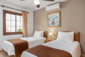 A bed or beds in a room at Sunset View Club By Diamond Resorts