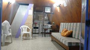 Area tempat duduk di Condomínio Sol Mar e Cia