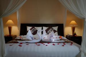A bed or beds in a room at ThanTha Ubud Villa