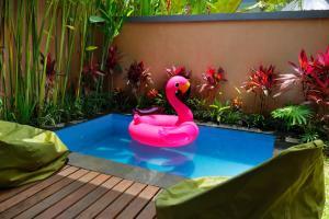 The swimming pool at or near ThanTha Ubud Villa