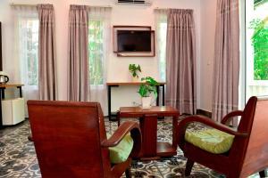 Coin salon dans l'établissement Villa Nanda