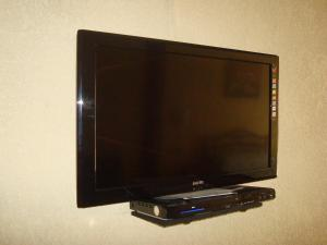 A television and/or entertainment center at Chez Pepe Apartments