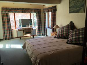 A bed or beds in a room at Marigold's 37 Critchley Common