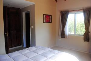 Una cama o camas en una habitación de Alma Satya Merlo