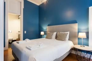 Cama o camas de una habitación en Baixa Vintage Three-Bedroom Apartment - by LU Holidays
