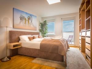 Krevet ili kreveti u jedinici u okviru objekta SKY9 Penthouse Apartments