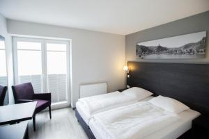 A bed or beds in a room at aparthotel Cochem